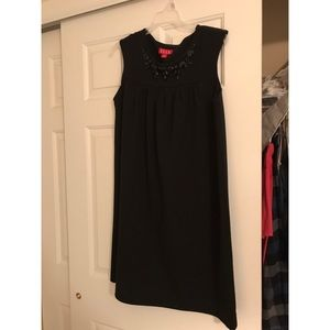 Little black dress with stone detail at neckline